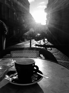 Coffee-cup-table-bicycle-sun-rays in echoing circles